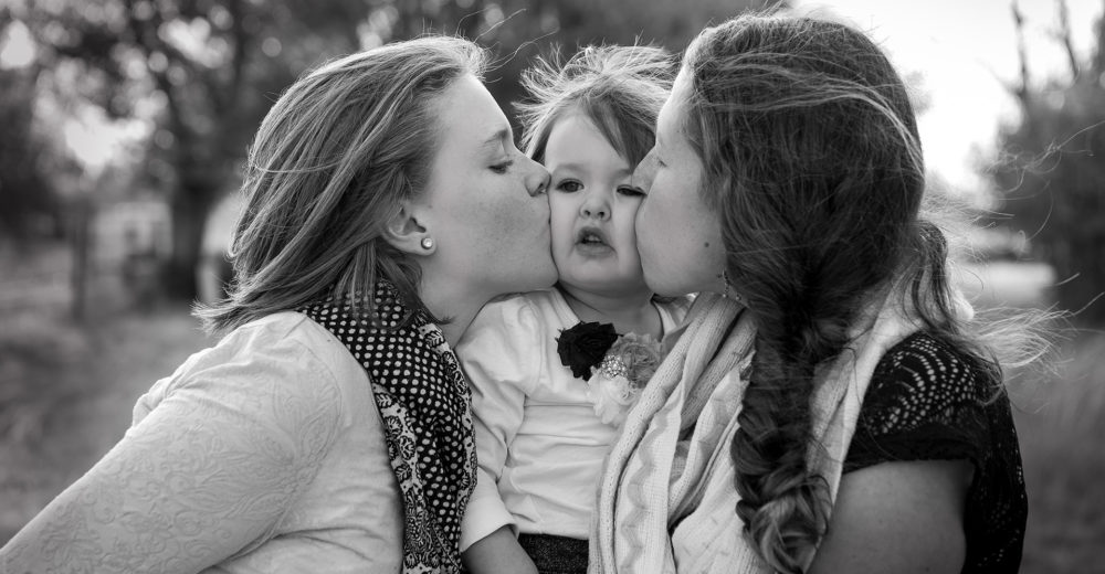sisters kissing